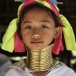 Stock Photo: Thailand, Chiang Mai, Karen Long Neck hill tribe village (KayLahwi), Long Neck young girl in traditional costumes. Women put brass rings on their neck when they are 5 or 6 years old and increase th