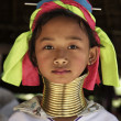 Thailand, Chiang Mai, Karen Long Neck hill tribe village (Kayan Lahwi), Long Neck young girl in traditional costumes. Women put brass rings on their neck when they are 5 or 6 years old and increase th — Stock Photo #11282979