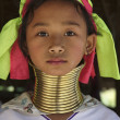 Thailand, Chiang Mai, Karen Long Neck hill tribe village (Kayan Lahwi), Long Neck young girl in traditional costumes. Women put brass rings on their neck when they are 5 or 6 years old and increase th — Stock Photo #11283059
