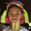 Thailand, Chiang Mai, Karen Long Neck hill tribe village (Kayan Lahwi), Long Neck young girl in traditional costumes. Women put brass rings on their neck when they are 5 or 6 years old and increase th — Stock Photo #11283129