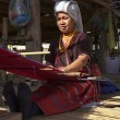 Thailand, Chiang Mai, Karen Long Neck hill tribe village (Kayan Lahwi), a Karen woman in traditional costumes is making a carpet — Stock Photo #11370708