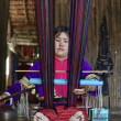 Thailand, Chiang Mai, Karen Long Neck hill tribe village (Kayan Lahwi), Karen woman in traditional costumes is making a carpet — Stock Photo