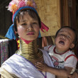 Stock Photo: Thailand, Chang Mai, Karen Long Neck hill tribe village (KayLahwi), Long Neck child and her mother in traditional costumes. Women put brass rings on their neck when they are 5 or 6 years old and in