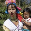 Постер, плакат: Thailand Chang Mai Karen Long Neck hill tribe village Kayan Lahwi Long Neck child and her mother in traditional costumes Women put brass rings on their neck when they are 5 or 6 years old and in