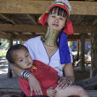 Stock Photo: Thailand, Chang Mai, Karen Long Neck hill tribe village (Kayan Lahwi), Long Neck child and his mother in traditional costumes. Women put brass rings on their neck when they are 5 or 6 years old and in