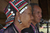Thailand, Chiang Mai, Karen Long Neck hill tribe village (Kayan Lahwi), Karen couple in traditional costumes — Stock Photo