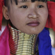 Thailand, Chiang Mai, Karen Long Neck hill tribe village (Kayan Lahwi), Long Neck woman in traditional costumes. Women put brass rings on their neck when they are 5 or 6 years old and increase the num — Stock Photo #11485535