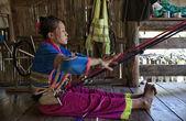 Thailand, Chiang Mai, Karen Long Neck hill tribe village (Kayan Lahwi), Karen woman making a carpet — Stock Photo