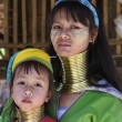 Постер, плакат: Thailand Chiang Mai Karen Long Neck hill tribe village Baan Tong Lhoung Long Neck woman with her child in traditional costumes Women put brass rings on their neck when they are 5 or 6 years old