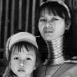 Royalty-Free Stock Photo: Thailand, Chiang Mai, Karen Long Neck hill tribe village (Baan Tong Lhoung), Long Neck woman with her child in traditional costumes. Women put brass rings on their neck when they are 5 or 6 years old