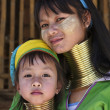 Stock Photo: Thailand, Chiang Mai, Karen Long Neck hill tribe village (BaTong Lhoung), Long Neck womwith her child in traditional costumes. Women put brass rings on their neck when they are 5 or 6 years old