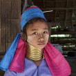 Thailand, Chiang Mai, Karen Long Neck hill tribe village (Baan Tong Lhoung), Long Neck young girl in traditional costumes. Women put brass rings on their neck when they are 5 or 6 years old and increa — Stock Photo