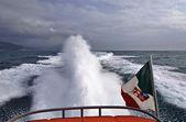 Italy, Tyrrhenian Sea, luxury yacht at full speed, backwash — Stock Photo