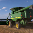 John Deer Combine Heading into Wheat Field — Stock Photo