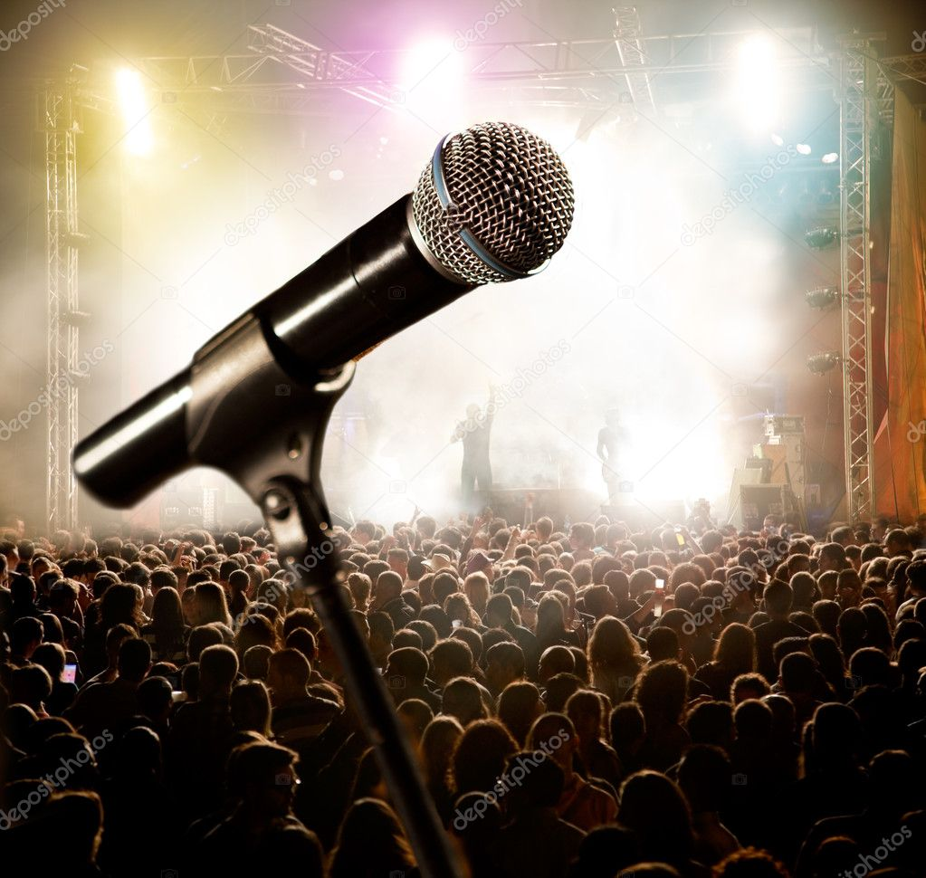 Live music background.Microphone and public — Stock Photo #11900015