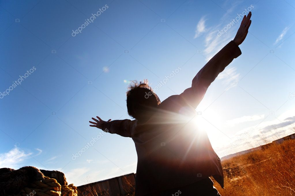 Silhouette of boy with open arms to the sky — Stock Photo #11900069