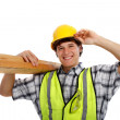 Young Happy Carpenter Holding Building Materials — Stock Photo