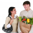 Smiling Young Couple with Groceries Shopping — Stock Photo #12144586
