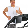 Healthy Young African American Running in Treadmill - Stock Photo