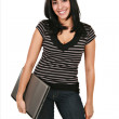 Royalty-Free Stock Photo: Casual Dressed Hispanic Female Student Holding Laptop