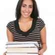 Casual Dressed Hispanic Female Student Holding Stack of Books - Stock Photo