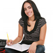 Happy Casual Dressed Hispanic Female Student Studying - Stock Photo