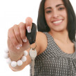 Pretty Hispanic Female Holding Car Key Isolated - Stock Photo