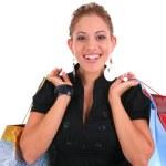 Smiling female shopper holding shopping bags — Stock Photo #12145351