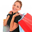Happy smiling female shopper — Stock Photo
