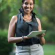 Stock Photo: Young African American Female Holding a Touch Pad Tablet PC