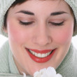 Smiling Female Eyes Closed with White Flowers — Stock Photo