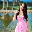Stock Photo: Girl in long pink dress