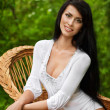 Stunning brunette beauty sitting on a chair — Stock Photo #11527379