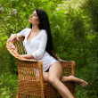 Stunning brunette beauty sitting on a chair — Stock Photo