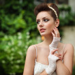 Very beautiful brunette in a wedding dress. — Stock Photo #11527426