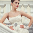 Very beautiful brunette in a wedding dress. — Stock Photo