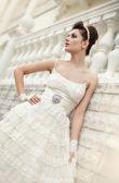 Very beautiful brunette in a wedding dress. — Stock Photo