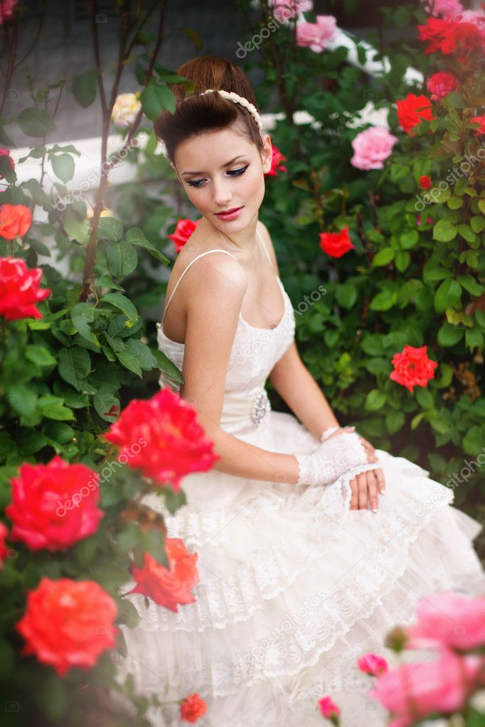 Very beautiful brunette in a wedding dress. Rero style — Stock Photo #11527458