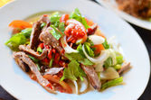 Spicy pork salad with vegetables — Stock Photo