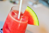 Oranges and Watermelon smoothie with drinking straws — Stock Photo