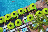 Top view of swimming pool side with a seat and umbrella — Stock Photo