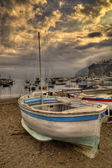 Gozzo,tipical italian boat, beached aground on the beach of the — Foto de Stock