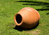 Clay vase on the grass — Stock Photo