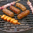 Royalty-Free Stock Photo: Barbecue with cevapi, meat skewer and ham