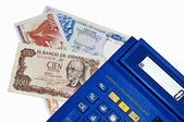 Euro-crisis,calculator with Peseta and Drachm banknotes — Stock Photo