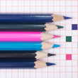 Colored pencils on notebook — Stock Photo