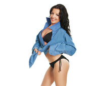 Fashion bikini girl model in man boyfriend shirt — Stock Photo