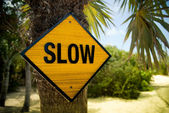 Yellow Slow Sign — Stockfoto