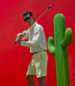 Man playing golf — Stock Photo