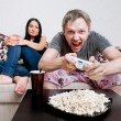 Young Couple Siting On Sofa At Home #1 — Stock Photo